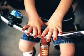 little boy wearing nail polish